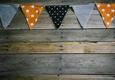 Halloween Triangle Banner at Top of Wooden Background stock photography