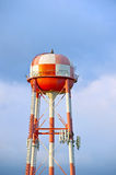 Orange & White Checkered Water Tower Royalty Free Stock Images
