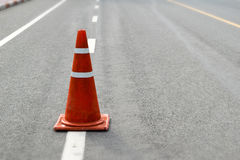 Orange and white cones on the road royalty free stock images