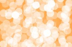 Orange and white defocused bokeh lights. In blur night background Stock Photo