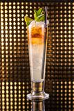 Orange and white layered cocktail in tall glass royalty free stock photo