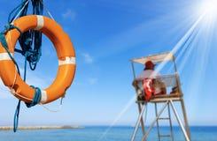 Lifebuoy and a Lifeguard on Surveillance Tower stock photo