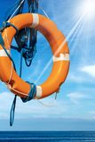 Lifebuoy on Blue sky with Sea and Sun Rays stock photography