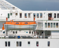 Orange and White Lifeboat on Luxury Cruise Ship Royalty Free Stock Photography