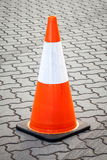Orange and White Movable Traffic Cone on Paved Street Royalty Free Stock Images