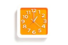 Orange White/Orange clock pointing at 1AM or 1PM royalty free stock photo