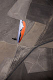 Orange and white paraglider pilot flying above the highway durin Royalty Free Stock Image