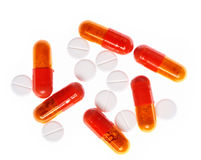 Orange and white pills Stock Photography