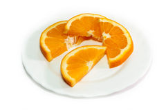 Orange on a white plate. Isolated object Royalty Free Stock Image