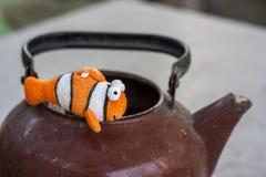 Orange and white plush fish Stock Photos