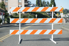 Orange and white road barricade Stock Photography