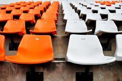 Orange and white seat in stadium Stock Photography