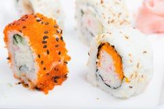Orange and white shushi rolls Stock Photo