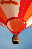 Orange and White Striped Hot Air Balloon in Flight Royalty Free Stock Image