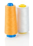 Orange and white thread on spools isolated Stock Photo