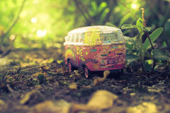 Orange and White Volkswagen T1 Scale Model Near Plant Royalty Free Stock Image
