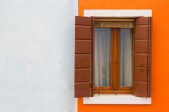 Orange-white wall and window close up Royalty Free Stock Image