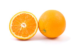Orange. Whole and half. Isolated on the white background Royalty Free Stock Photo