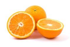Orange. Whole and halves. Isolated on the white background Stock Image