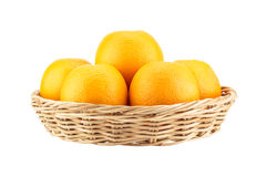 Orange in wicker basket Stock Photo
