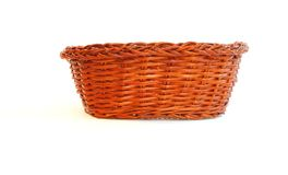 Orange wicker basket side view isolated Royalty Free Stock Images