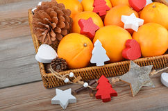 Orange in wickered tray with Christmas decor Stock Images