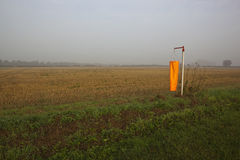 Orange wind sock in mist Stock Images