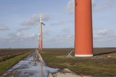 Orange wind turbines on the dutch island of flevoland near Almer Royalty Free Stock Photo