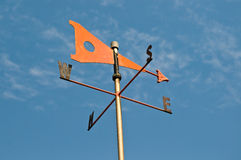 Orange wind vane Royalty Free Stock Image