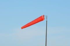 Orange Windsock against Blue Sky Stock Photo