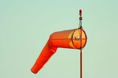 Orange windsock at airport Stock Photos