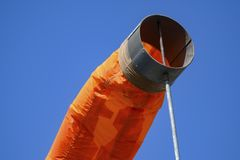Orange windsock in the wind royalty free stock image