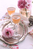 Orange wine. French orange-infused dessert wine served in small glasses Stock Photos