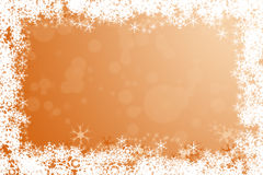 Orange winter holidays background framed with snowflakes Stock Photo