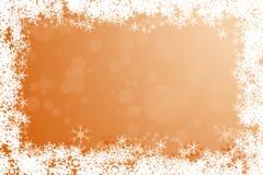 Orange winter holidays background framed with snowflakes Stock Photo