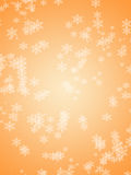 Orange winter holidays background with white snowflakes. Orange shiny winter holidays background with white snowflakes. Snowflakes pattern/texture Royalty Free Stock Image