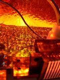 Orange Wire Technology Party #3. An assortment of technology under a weird orange fiery haze. Some of the circuit boards, wires, and other assorted equipment Royalty Free Stock Image