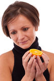 Orange in woman hands Stock Photography