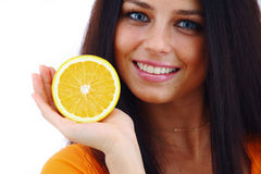 Orange in woman hands Royalty Free Stock Images