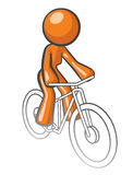 Orange Woman Riding Bike Stock Photography