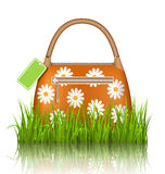Orange woman spring bag with chamomiles flowers and sale label i Royalty Free Stock Photos
