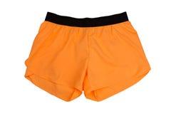 Orange women`s sports shorts. Isolate. On white background Royalty Free Stock Photos