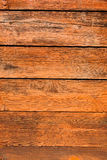 Orange wood background. Painted wooden plank Royalty Free Stock Photo