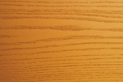 Orange wood background. Wooden background with orange streaks in relief Stock Photography