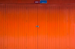 Orange wood door Royalty Free Stock Photography