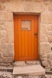 Orange wood door street and doorway Royalty Free Stock Photos