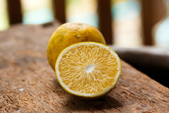 Orange on wood Stock Image