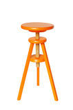 Orange Wood Stool. Vivid orange wood stool isolated on pure white background royalty free stock photography