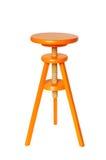 Orange Wood Stool. Vivid orange wood stool isolated on pure white background Royalty Free Stock Photography