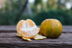 The orange on wooden background Stock Photo